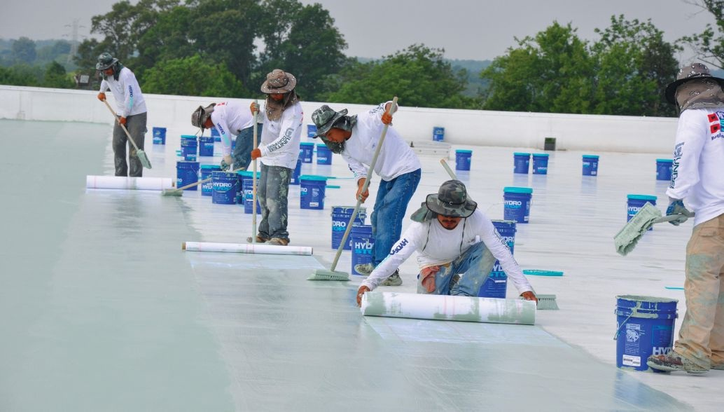 Installation of a liquid membrane system using a water-based acrylic topcoat
